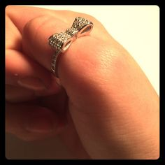 Sterling Silver and CZ Ring Bow tie ring, sterling silver/CZ, size 7. Tried to capture the 925 on the inside pictured above. No stones missing, perfect for any day or occasion, just too big for my fingers. Jewelry Rings