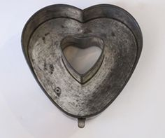 "vintage heart pan  Heart Shaped Springform Pan  a vintage heart-shaped springform tube pan--beautifully made--rolled edges--bottom lifts out--patent number on bottom--looks great hanging on the wall  10"" h x 9 1/2"" w  $  245.00 WOW you got to be kidding me!"