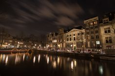 Beautiful night at Amsterdam  - http://wowinfobucket.com/the-most-incredible-photos-of-amsterdam-from-dawn-to-night/