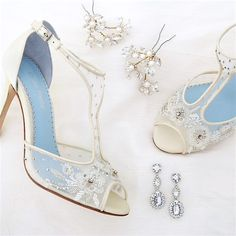 A girl's best friend.  Shoes & jewels. Wedding shoes by Bella Belle, bridal earrings & hairpins by Erin Cole.