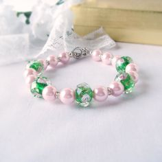 Girls Flower First Communion Bracelet in Pink Pearls Light Green Lampwork Flower Focal Beads and Tiny Rhinstone Rondelles Spacers