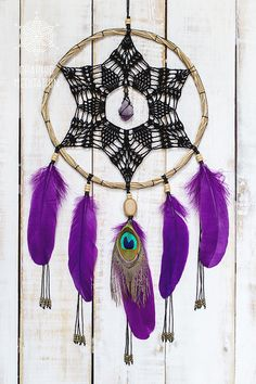 Magic black and purple dream catcher with raw amethyst crystal and peacock feather