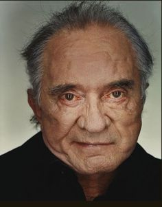 """""""I'd rather die than retire,"""" Johnny Cash told Rolling Stone in November """"Like a shark — got to keep moving."""" This portrait, taken in Cash's home by Martin Schoeller, captures the fierce optimism of The Man in Black, who passed away eleven months l Martin Schoeller, Johnny Cash June Carter, Johnny And June, Country Singers, Country Music, Outlaw Country, Country Artists, Cash First, Musica Country"""