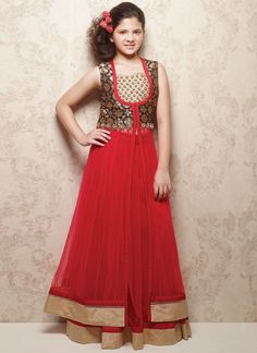 Doll Red Net Kids Long Choli Red net kids long choli lehenga from Doll looks chic with the sequined neck patch and jacquard yoke on the choli. Shimmer hemline patches complete the look.