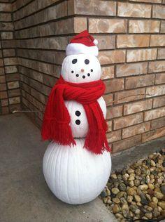 I LOVE this reuse of pumpkins for winter decor!  Pumpkin snowman