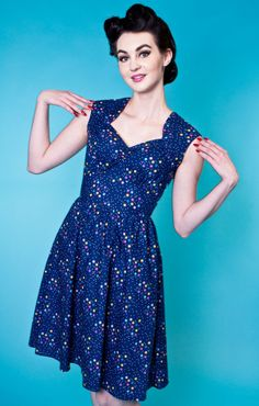 The Maxine Dress A flirty retro silhouette with these features: - 100% Quality cotton print - Soft gathers over bust to fit a variety of shapes - Approximately 32 inches from underarm to hem - Flatter