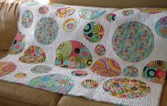 from The Quilting Edge. #quilts.  There is just something very magical about quilts with circles on them, at least to me
