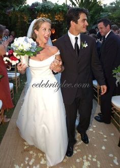 Christina Applegate's wedding dress - a hand-beaded silk organza gown by Reem Acra. Her hair was styled by Ken Paves and worn in a loose chignon, with a 100-year-old Cynthia Bach diamond-encrusted comb. She carried a bouquet of white and lavender blossoms to match her bridesmaids' lavendar Reem Acra gowns. The groom wore a black Hugo Boss suit.