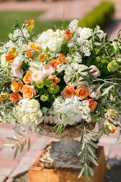orange and white floral arrangement // photo by Chris + Jenn Photography // styling by Styling Starts Here // view more: http://ruffledblog.com/romantic-agoura-hills-wedding