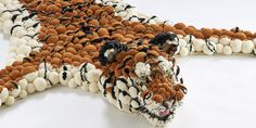 MYK Tiger head close up. Tiger rug made out of pom poms Tiger Silhouette, Tiger Rug, Tiger Head, Pom Pom Rug, Pom Pom Crafts, Brocade Fabric, Carpet Design, Yarn Projects, Hair And Beard Styles