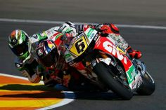Stefan Bradl #6 with Alvaro Bautista behind looking for a way through.
