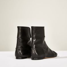 Image 4 of STUDIO FLAT ANKLE BOOTS WITH ZIP from Zara