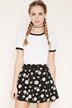 This woven skater skirt features an allover daisy print with a concealed side zipper.