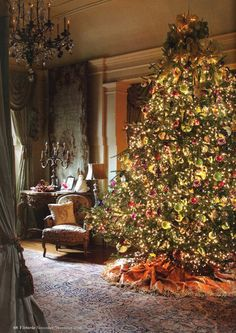 lovely chandelier pales in comparison to the glow of Christmas .. victoria magazine christmas