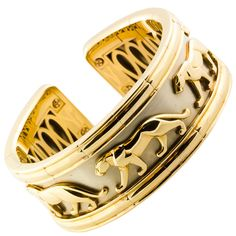Cartier White Yellow Gold Panther Cuff Bracelet | From a unique collection of vintage cuff bracelets at https://www.1stdibs.com/jewelry/bracelets/cuff-bracelets/