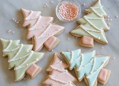 Fill in these chic christmas cookies with pink, blue, or green royal icing. Sprinkle sanding sugar on top and lay pink pearl nonpareils for decor. Get the recipe at Bake at cookies Easy Christmas Treats That'll Make Holiday Baking Even More Joyful Easy Christmas Treats, Christmas Tree Cookies, Christmas Sweets, Christmas Cooking, Noel Christmas, Christmas Goodies, Holiday Cookies, Holiday Treats, Simple Christmas