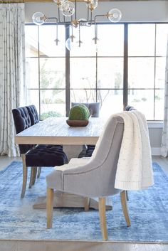 ransitional modern dining room gray tufted dining chair black tufted dining chair blue vintage inspired rug kravet riad curtains sherwin williams mindful gray paint-1
