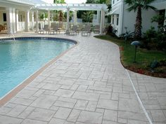 stamped concrete patios around a pool | Stamps