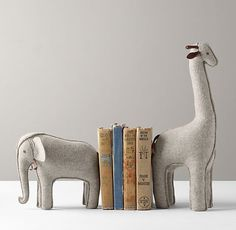 Like these wool felt bookends for kids from Restoration Hardware Baby & Child / Pair this with hand-painted safari stick-on wall mural decals by Muralistick. Check out more pictures and wonderful themes here: www.muralistick.com