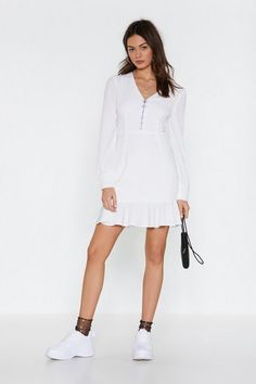 This dress features a V-neckline, mini silhouette, hook and eye closures at bust, blouson sleeves, and ruffle detailing at hem. Pop Fashion, Fashion Outfits, Sexy Shorts, White Mini Dress, Nasty Gal, Short Dresses, Clothes, Shopping, Neckline