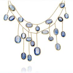 Kyanite Necklace  - this has a pretty asymmetrical design.  (Look at it on!)  And for a mere $8,670 you can own it!