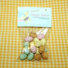 HEADER CARD BAGS filled with 50g solid candy coated, milk chocolate eggs. Personalised header card.