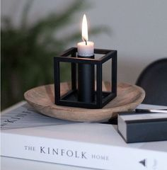 Evening candlelight with the Kubus 1 candleholder in this image by Candleholders, Candle Lanterns, Candlesticks, Living Room Inspiration, Interior Inspiration, Kinfolk, Nordic Design, Scandinavian Home, Danish Design