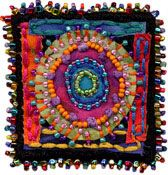 this is a fun mess of beads, scraps and stitches....I love it!