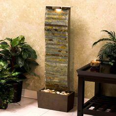 wandbrunnen design beleuchtet garten pflanzen