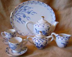 Decorative Dishes - Doll Tea Set - Elegant Miniature Blue White Gold Leaf Teapot Cups Sugar Creamer Tray, $39.99 (http://www.decorativedishes.net/doll-tea-set-elegant-miniature-blue-white-gold-leaf-teapot-cups-sugar-creamer-tray/)