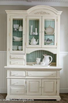 An inexpensive thrift-store hutch with good bones gets a makeover of distressed beadboard backing and glazed white paint by Start at Home Decor
