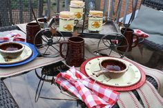 I totally dig the wagon centerpiece and how hte napkins are tied on this western tablescape!