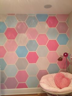 Instructions: you must have 1 inch thick painters tape, a hexagon stencil, and paint.  Place the stencil on the wall and put tape around the stencil. Cover the entire wall with hexagons.  Paint with in the tape in any pattern you would like.  Pick about five base colors including white and gray to mix.  I started out with blue and pink.  Once you're done painting remove the tape and, voilà!  Enjoy your beautiful wall! -Original Pin by Aubrey Spicola