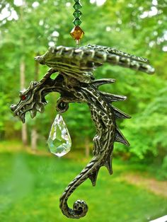 Celtic Dragon - Pewter and Swarovski Crystal Suncatcher - Pewter dragon discontinued by manufacturer. $37.00, via Etsy.