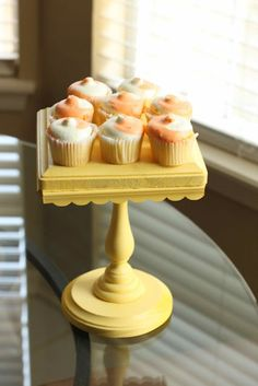 Clever idea for DIY cake stand.  Wood Block, trim and candle stick.