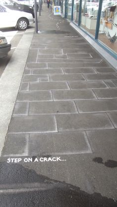 "Fake cracks as part of footpath decoration. ""Capital Gateway Centre"" Thorndon Quay, Wellington."