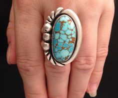This is a lovely, size 9.5 Number 8 turquoise ring made by Tommy Singer in his early days. The T hallmark on the back was his first known
