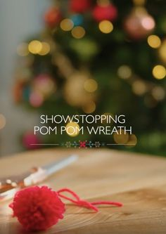 Create an alternative Christmas wreath with homemade pom poms and dazzling decorations. Coordinate different textures of wools and yarns to reflect your festive decor.