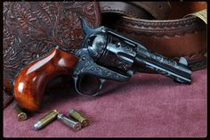 Bird head grip. Engraved. 45 Long Colt. They don't get much prettier than this.