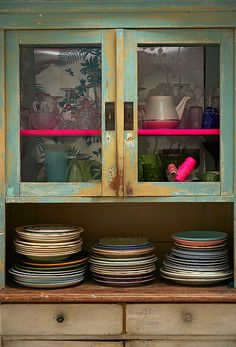 Neon strip to brighten up a glass cabinet. Mixed plates- no need to match