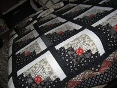 Dana Weltz' black and white quilt..love the red center in log cabin block
