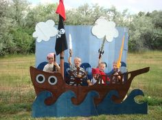 "Kidds Pirate Birthday Party - backdrop. We also dressed them up scars and beards w/ watercolor paints (better to do this *after the squirt gun water fight), did a ""walk the plank"" balance beam game, and an ""x marks the spot"" version of pin the tale on the donkey - eye patches worked well for the blind fold - a silver hook from tin foil fished out their funyun chips, and red, black and white streamers lined the trees, same color balloons gathered as a centerpiece for the table and was…"
