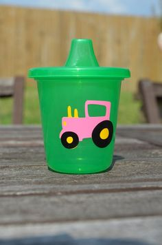 10 pink Tractor sippy cups party favors. $20.00, via Etsy.