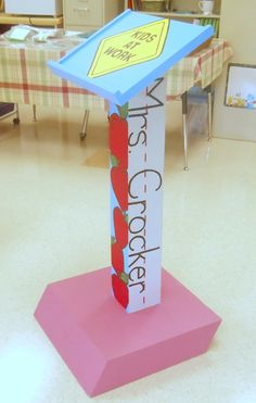 My sister, Janell has a wooden podium for sale for $15 OBO if somebody is interested in doing this! DR Cute!