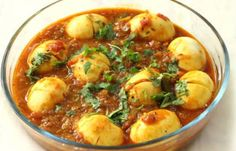 Andhra Egg Curry (Kodi Guddu Pulusu) Recipe Breakfast and Brunch, Main Dishes with eggs, onions, green chilies, tomatoes, ginger, ground turmeric, chili powder, coriander powder, tamarind paste, curry leaves, oil, cinnamon, black mustard seeds, coconut milk, cilantro leaves, salt