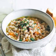 Learn how to make this delicious simple to prepare ham and bean soup using leftover ham. It's loaded with flavor and can be cooked on the cook top, in an instant pot, or in a crock pot. Don't miss out on this comforting soup recipe. #soup #ham #recipes Bean Soup Recipes, Chowder Recipes, Ham Recipes, Gourmet Recipes, Turkey Recipes, Italian Recipes, Ham And Beans, Ham And Bean Soup, Cioppino Recipe