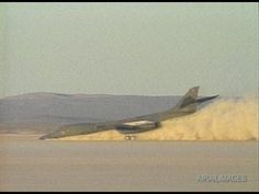 """Successful crash landing of a """"Bone"""" (85-0070) on the surface of Rogers Dry Lake at Edwards Air Force Base, where the plane was diverted after an in-flight failure to the #2 hydraulic system prevented it from lowering the nose gear."""