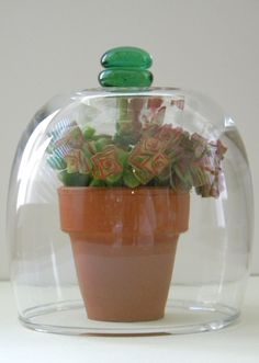 diy bell or cloche jars made with Dollar Store items. I think I'd like it better with a drawer pull handle.