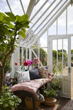 Styled by Selina Lake, this greenhouse has the perfect little space for a bench and cushions.