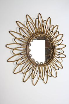 Spanish Rattan Flower Burst Mirror | From a unique collection of antique and modern sunburst mirrors at https://www.1stdibs.com/furniture/mirrors/sunburst-mirrors/